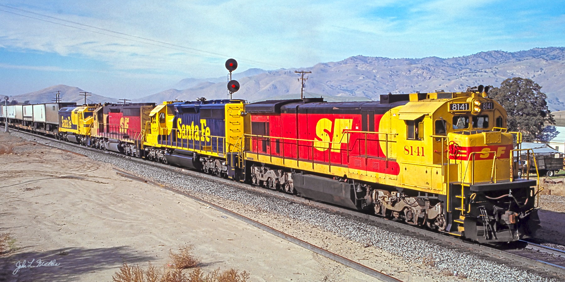 ATSF C30-7 8141 eastbound at Bealville, CA in December, 1988.