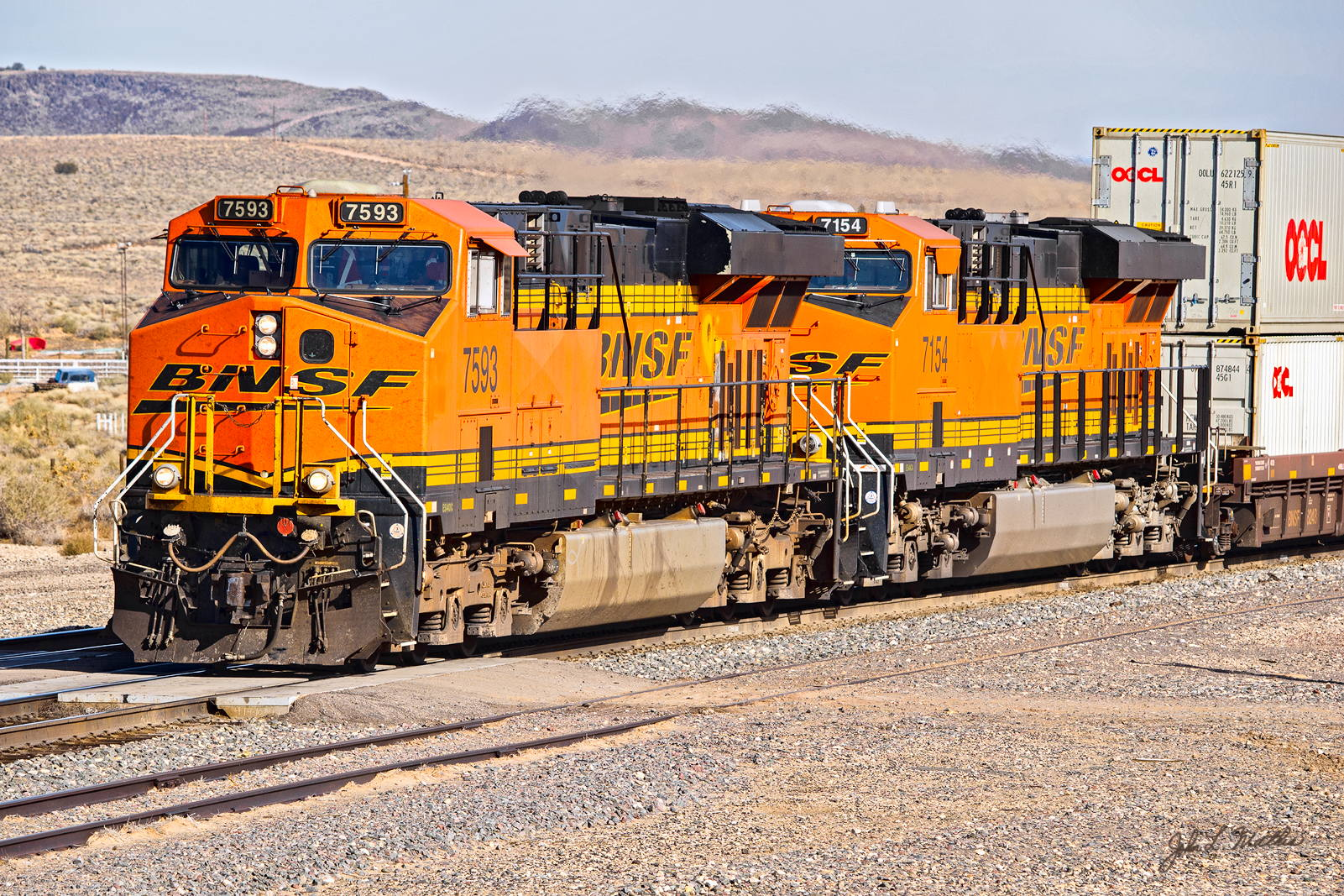 BNSF 7593 and 7154 are westbound at Dalies Jct., NM on November 29, 2013..
