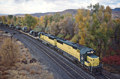 CNW SD50's 7029 and 7024 lead a westbound military train through Weber Canyon in October 1988.