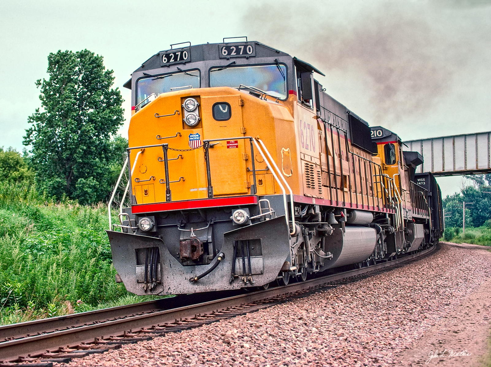 UP 6270 has just passed under the IC (now CN) overpass west of Missouri Valley, IA in July 1993.