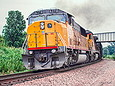 UP 6270 has just passed the IC (now CN) overpass west of Missouri Valley in July 1993.